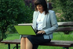 Businesswoman finishing work and relax on park bench, outdoors NTSC Stock Footage