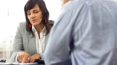 Businesswoman signing contract with male client HD Stock Footage