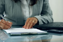 Businesswoman hands signing documents on reflective table NTSC - stock footage