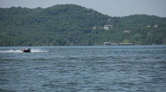 Boat cruising on a lake Stock Footage