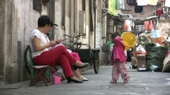 Shanghai backstreets, slums, old town, women knitting, traditional lifestyle Stock Footage