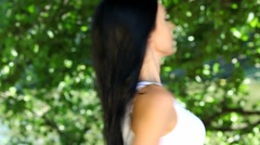 Dark-haired in park Stock Footage