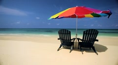 Sun Parasol & Chairs on a Tropical Beach Stock Footage