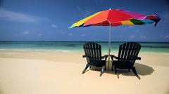 Sun Parasol & Chairs on a Tropical Beach - stock footage