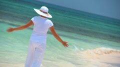 Young female celebrating on a Tropical beach - stock footage