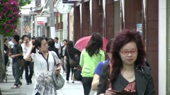 China shopping, attractive girl, face expression, expensive, street, wealthy Stock Footage