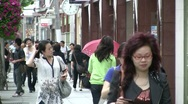Stock Video Footage of China shopping, attractive girl, face expression, expensive, street, wealthy