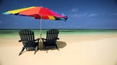 Sun Parasol & Chairs on a Paradise Beach Stock Footage