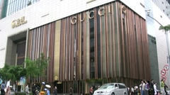 Traffic passes Gucci building in Shanghai Stock Footage
