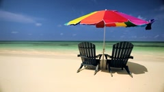 Beach Escapism with Sun Parasol & Chairs Stock Footage