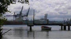 Commercial docks - lonely fishing boat Stock Footage