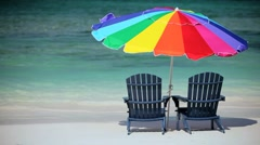 Chairs in Gentle Ocean Waves on Luxury Beach Stock Footage