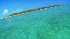 Aqua green waters with a beautiful Island in a tropical location Stock Footage