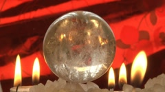 Moonstone ball and candles Stock Footage