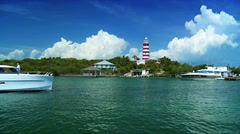 Beautiful tropical Island Lighthouse with passing craft Stock Footage