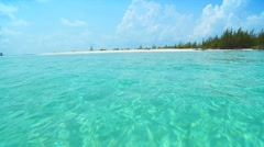 Aqua green waters with white sandy beach in a tropical location Stock Footage