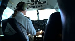Male Light Aircraft Pilot maneuvering his light plane while in flight Stock Footage