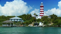 Lighthouse on a Tropical holiday Island surrounded by a turquoise sea Stock Footage