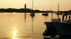 Tropical Island Lighthouse and reflection of the setting sun. Stock Footage