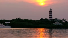 Tropical Island harbour lighthouse at Sunset, Caribbean Stock Footage
