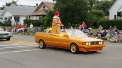 Ronald Mcdonald at a parade Stock Footage