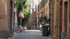 Savona Italy women in alley P HD 8776 Stock Footage