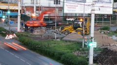 Excavator works on the road time lapse Stock Footage