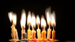 Birthday candles changing into fire - stock footage