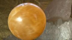 Orange crystal ball Stock Footage