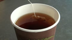 A tea bag in hot water Stock Footage