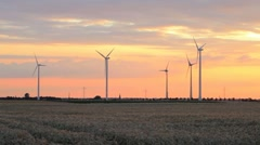 Electrical wind turbines at sunset - stock footage