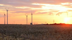 Electrical wind turbines at sunset Stock Footage