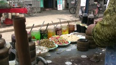 Making hot and sweet candy in traditional Muslim quarter in Xian, China Stock Footage