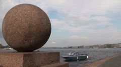 Granite ball on the waterfront Stock Footage