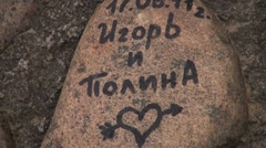 Stock Video Footage of The inscription on the granite rock