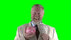 Man with piggybank Stock Footage