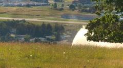 Agriculture, irrigation sprinklers long shot Stock Footage