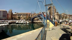 Savona Italy tourists on draw bridge P HD 0005 Stock Footage