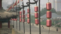 Red lanterns at Xian city wall, historical city in Central China Stock Footage