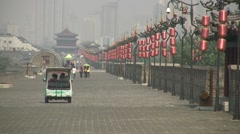 Electric cart on ancient city wall in Xian, China Stock Footage