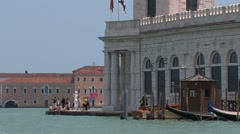 Ancient customs building at canal in Venice, Italy Stock Footage