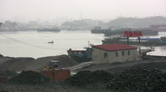 Coal depot China, polluted river, industrial, smog issues, industry - stock footage