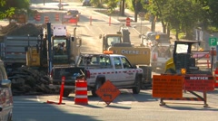 Road construction in city centre, long shot with traffic Stock Footage
