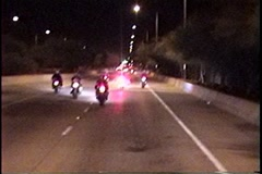Motorcycle cop follows a group of riders Stock Footage