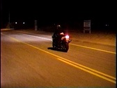 "Stock Video Footage of Motorcycle performs a trick called a ""stoppie"" on a public road"