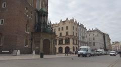 People walking near St. Mary's Basilica, Krakow, Poland Stock Footage