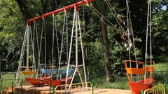 Young pair on a swing Stock Footage