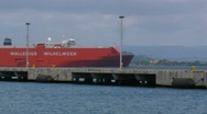 Stock Video Footage of Red Car Cargo Ship Vessel in harbor