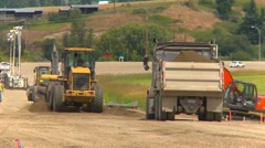 construction highway building, #9 loader and dump truck - stock footage