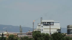 Chemical facilities with flaming chimney Stock Footage